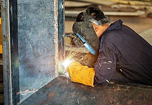 worker-welding-construction-by-mig-welding.jpg