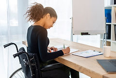 portrait-young-signing-papers-office.jpg