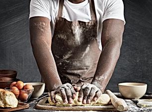 man-wearing-apron-baking-kitchen.jpg