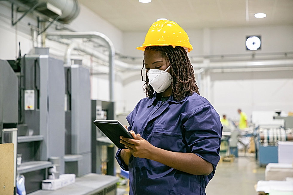 female-factory-worker-mask-holding-table