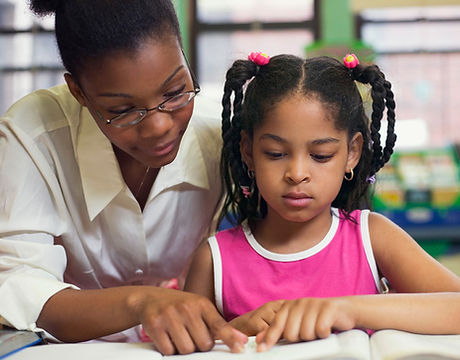 home child care provider helping young person with homework