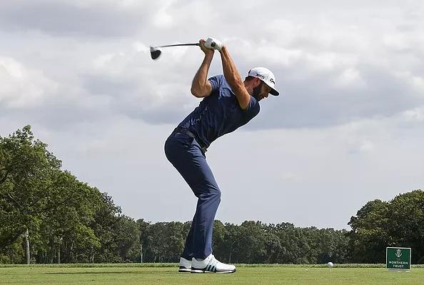 Golfer Dustin Johnson top of driver backswing