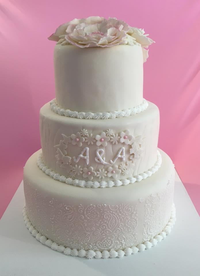 Hochzeitstorte Spitze rosee