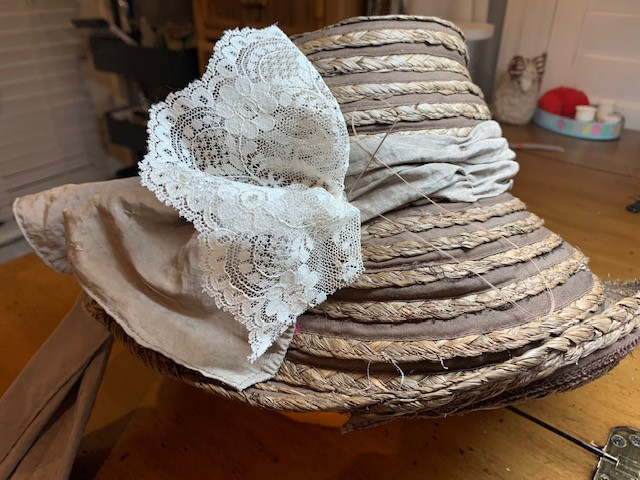 sewed extra lace on bonnnet