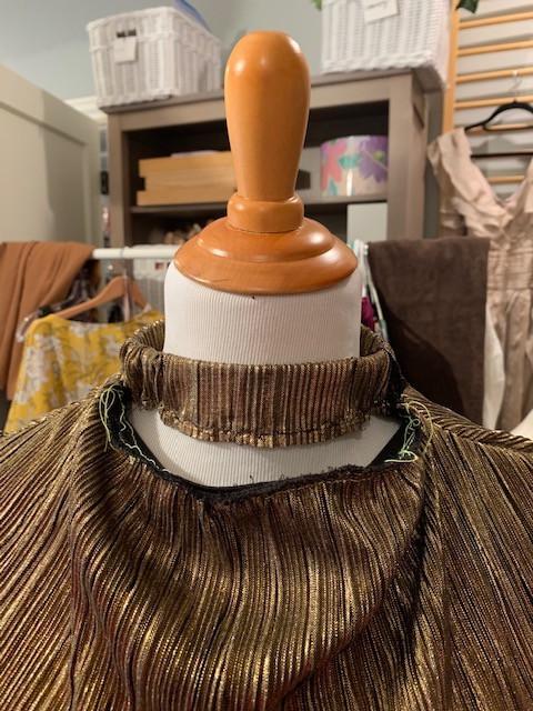 Reworking Neckline on Thrifted Gold Metallic Tiered Skirt on Mannequin