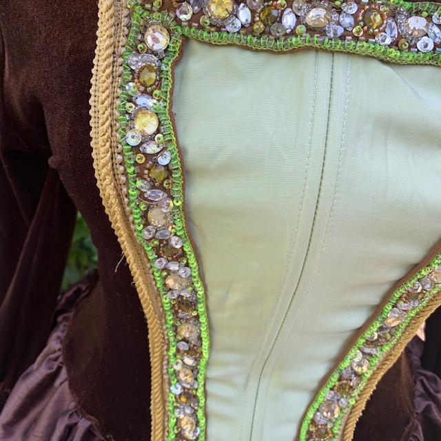 Close-up of Upcycled Green Rhinestone Applique Used For Renaissance Costume