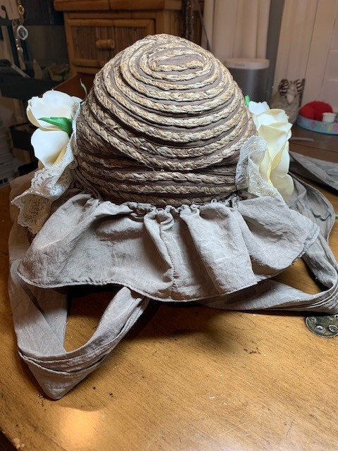 ruffle/curtain sewn on back of bonnet to cover up criss-cross
