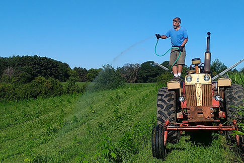 Bob-stand-on-tractor-watering-2.jpg