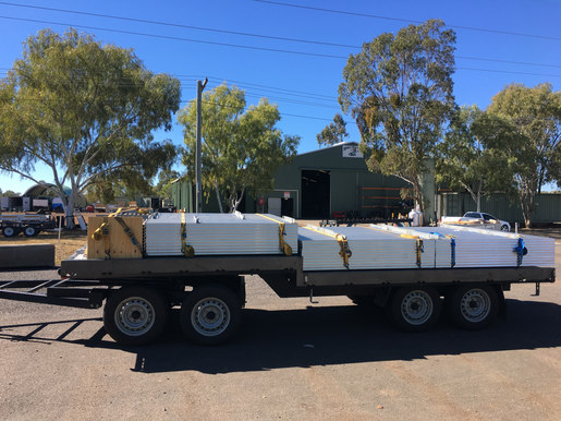 Little Dog Trailer loaded with Aluminium Posts