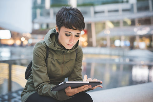 Young%20Woman%20Reading%20Tablet_edited.jpg