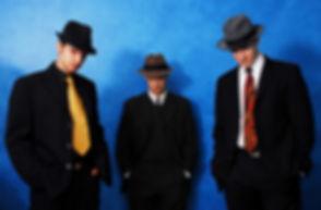 Trio West Standing HeadsDown.jpg