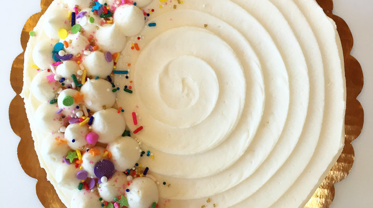8 in white cake with sprinkles $55