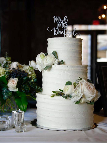 3 tier simply iced with fresh floral