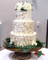 three tier hand piped cake