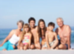 Canva - Family Sitting beside the Beach.