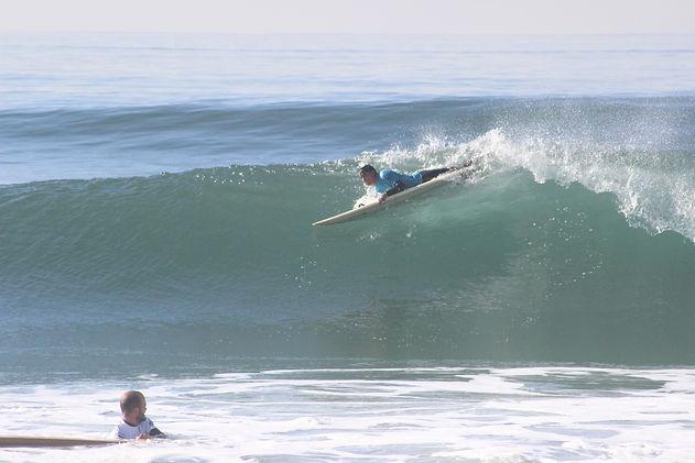 Jacob surfing a wave in huntington beach california