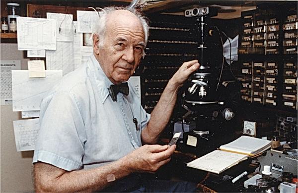 McCrone at microscope copy.jpg