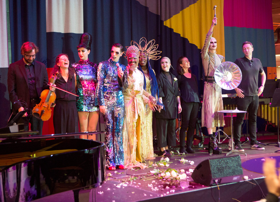 A line of performers onstage during the bows.