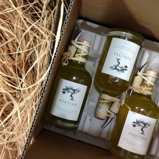 Olive Oil in Case with Raffia bunch.jpg