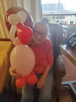 Bridgepoint resident happily receives her Balloon Buddy
