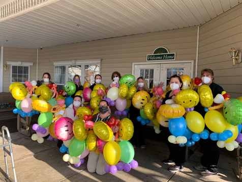 An amazing image, as the caregivers hold the Balloon Buddies
