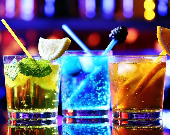 Glasses of cocktails on bar background.j