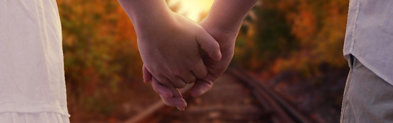 couple-holding-hands-banner.jpg