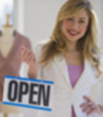 female clothing store worker opening up
