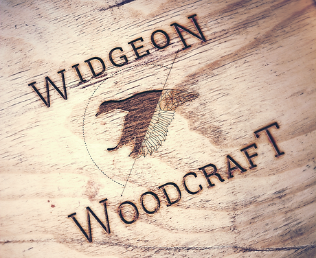 Widgeon Engraved Wood Mock Up (Main Logo).png