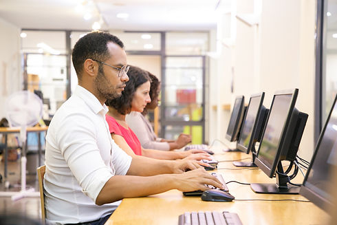 diverse-group-students-taking-online-tes