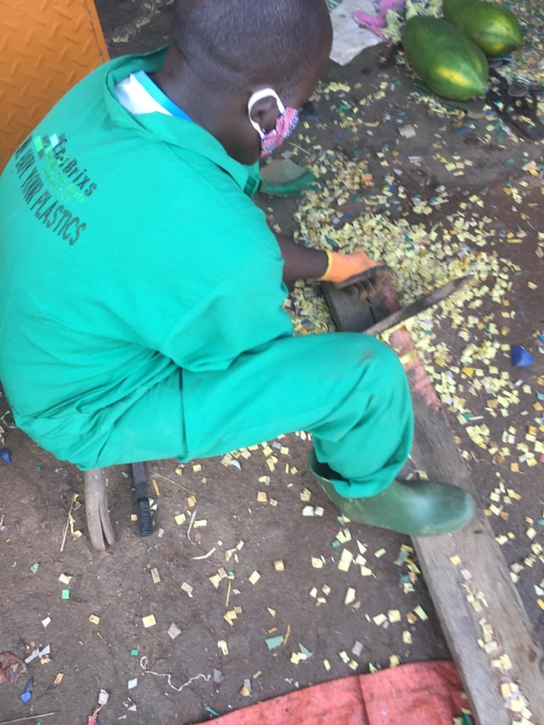 The Eco Brixs team shredding HPTE plastic bottle lids into Granules to make Face Shields