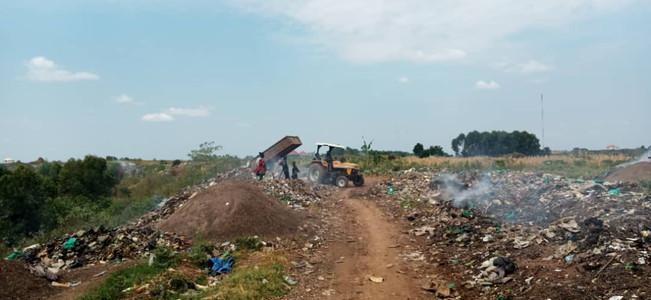 Piles of plastic waste being burned in Uganda
