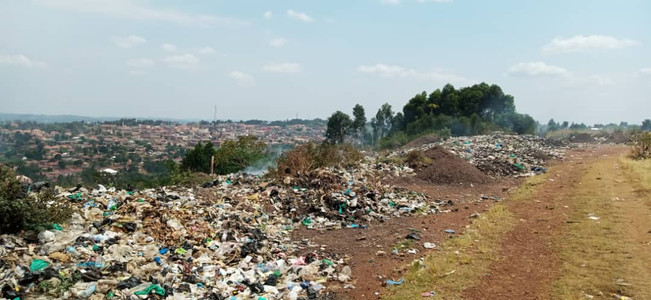 Plastic waste and other trash being dumped in the Ugandan countryside due to lack of waste management systems