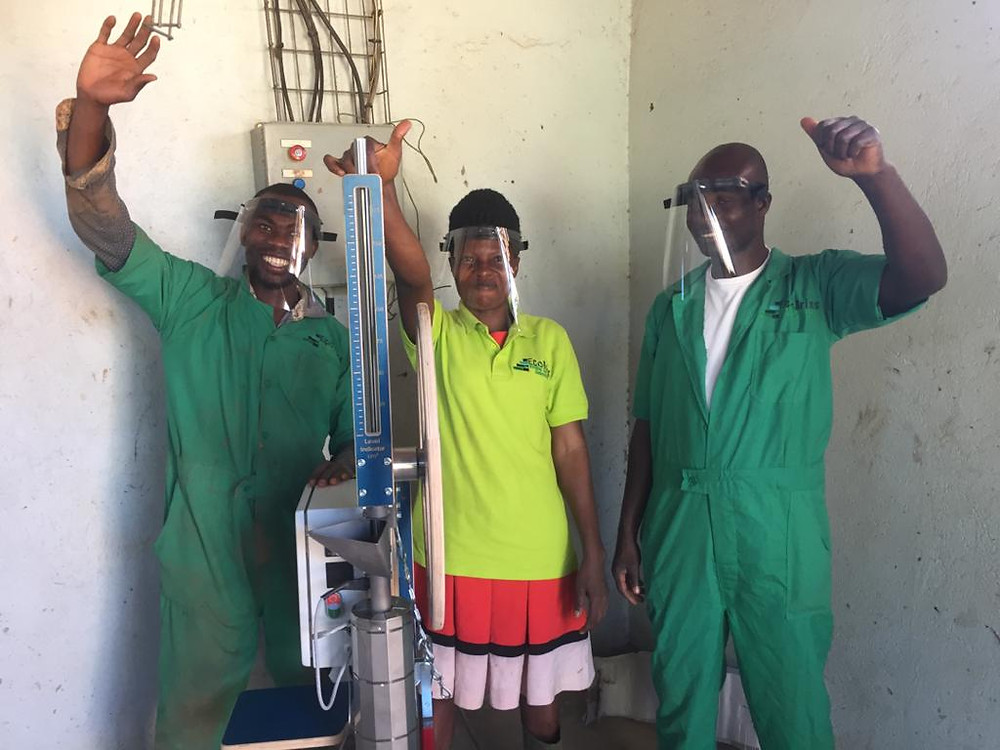The Eco Brixs team in Uganda with the new machines to make plastic face shields to protect frontline workers from COVID-19