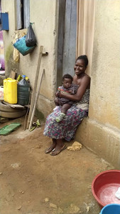A mother and child are relieved to receive food and soap to help survive the lockdown in Masaka
