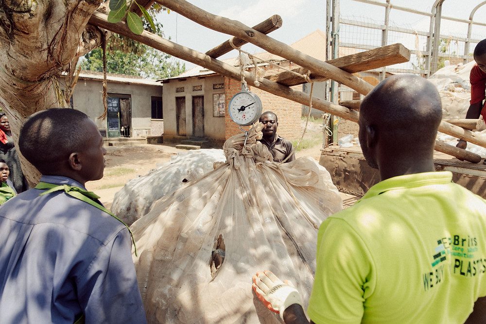 Eco Brixs' team weighing plastic at Eco Brixs headquarters in Masaka, Uganda
