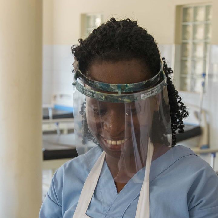 Uganda nurse at a clinic with a plastic covid-19 face shield made from recycled plastic waste