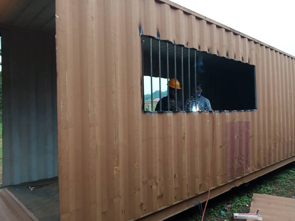 Upcycling shipping containers at Eco Brixs HQ to hold machine lines for Eco Bricks