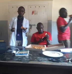 Doctors at Masaka Referral hospital take a well earned break to have some pizza during coronavirus crisis