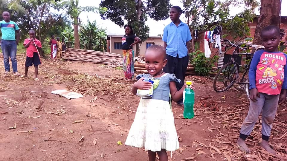A young girl is happy to receive food and soap for her family during the Coronavirus crisis