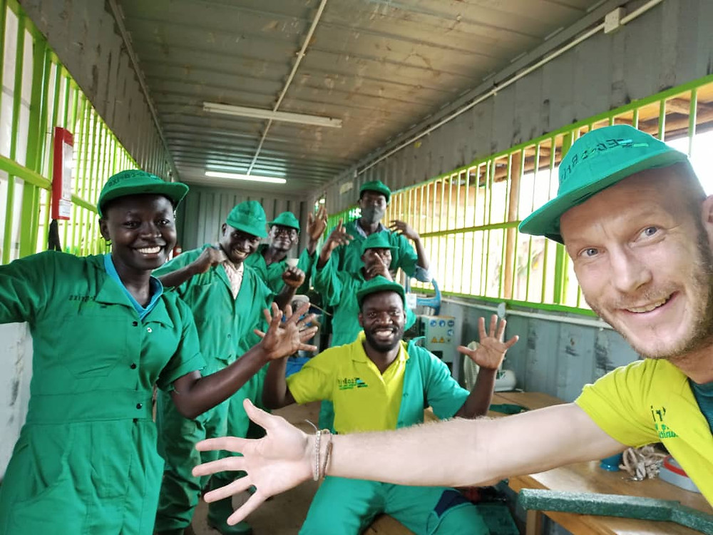 Eco Brixs team at HQ in Uganda where Eco-Products are made from recycled plastic, wearing our new Eco-Hats