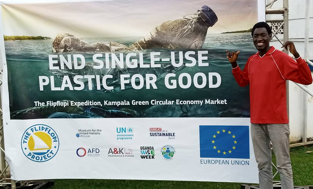 Sian from the Eco Brixs team at the Flip Flopi event by end single use plastic campaign banner