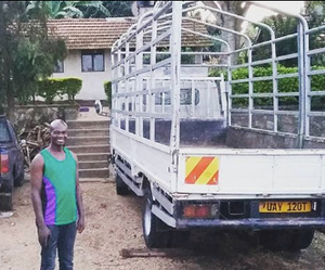 JOHNSON MUSINGUZI Eco Operations Manager poses with the truck