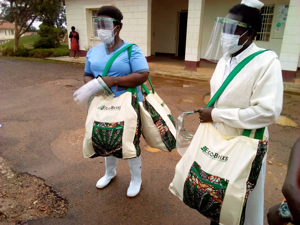 Ugandan doctors and nurses with COVID-19 Plastic Face Shields made from recycled plastic waste by Eco Brixs