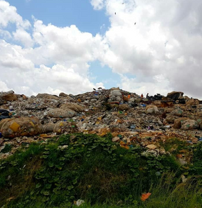 Tonnes of plastic waste at a landfill site near Kampala