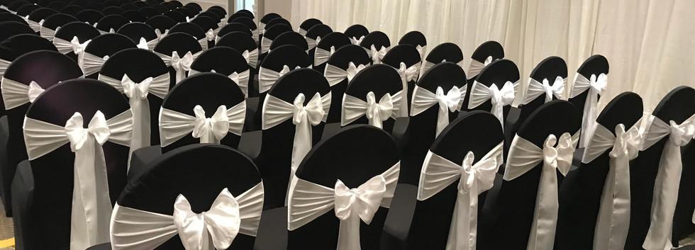 Black spandex w white satin bow.jpg