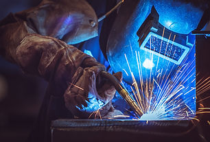 Image of welder creating blue flame on his materials
