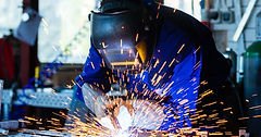 Image of welder with a steady hand on his materials
