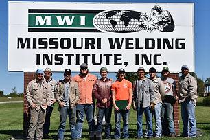 Image of recent graduation class of MWI