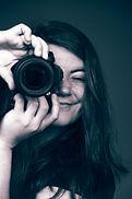 Headshot-Wcamera-SM.jpg